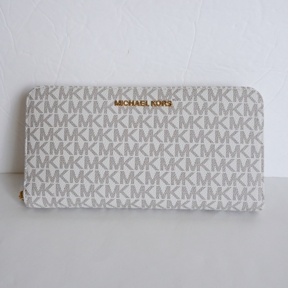 35bcf7aade68 Michael Kors Jet Set XL Zip Around Wallet Vanilla
